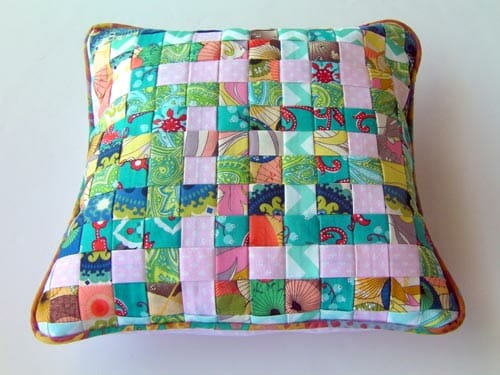 Woven fabric pillow made from weaving strips of folded fabric. Great scrap buster and so pretty too!