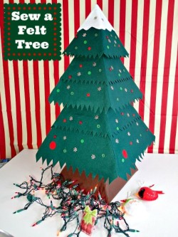 I'm in love with this felt Christmas Tree! Too cute and you should see the ornaments too!