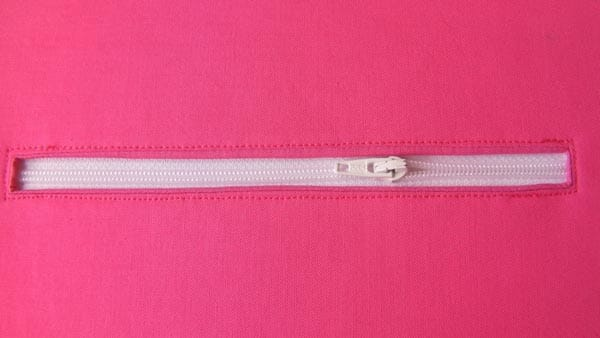 Clear instructions and a video on how to add a zipper pocket either to the inside or outside of a bag.
