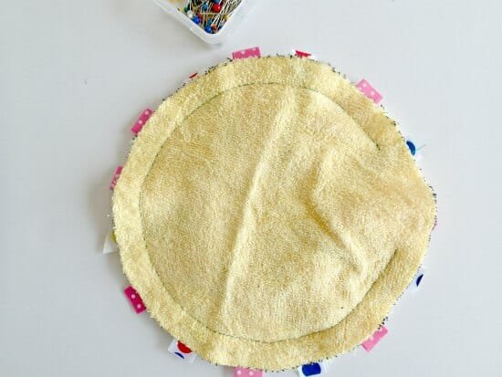 Easy and quick to make terry and ribbon baby toy.  Could use an old towel too.