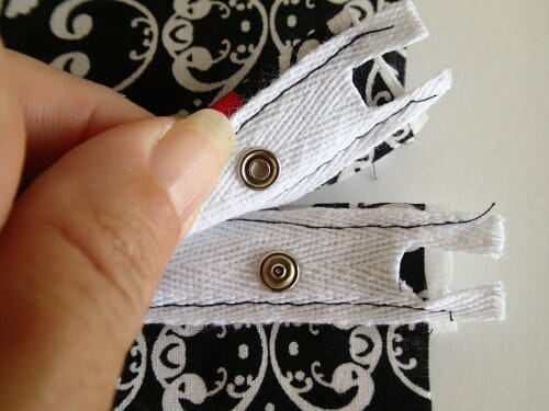 Sew the tape in place on the right side of the fabric.