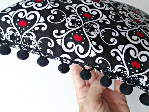 Make luxury bedroom pillows with pom pom trim and snap tape backs. Love the idea of using a velvet too.