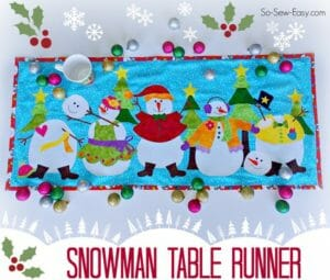 Love the bright colors in this snowman table runner. Would also make a great mini quilt or wall hanging.