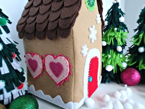Felt Gingerbread house. This is a tissue box cover, but you could easily stuff it, or use an empty tissue box as the frame. I'll be making a mini village!