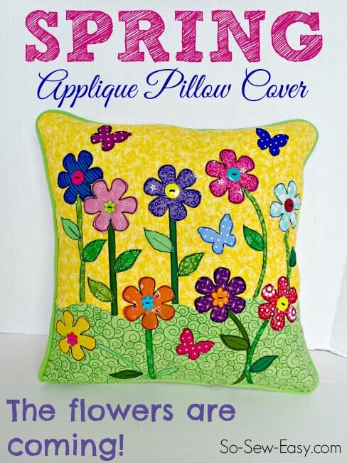 Love the bright colors in this Spring Applique Pillow Cover idea.  The raised flowers and buttons add a nice touch.