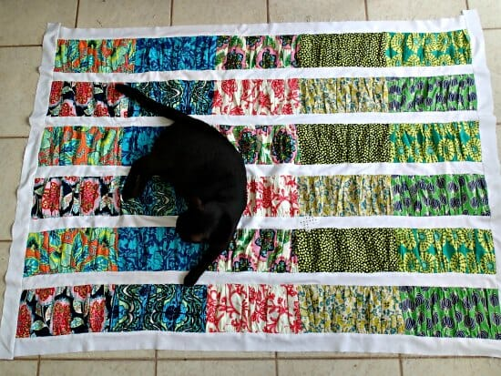 Fun way to make a quilt top, entirely from fat quarters gathered into jelly roll strips. Love the gathered look.