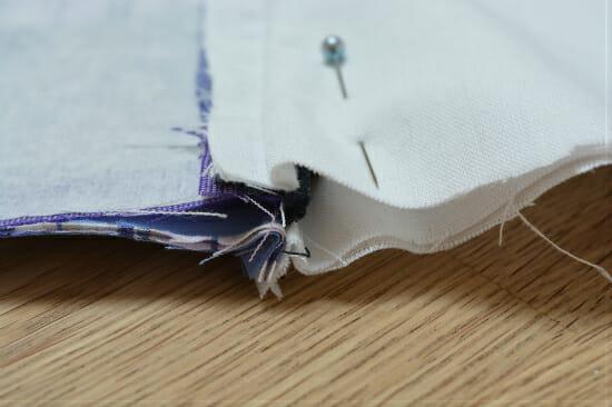 fold zip towards lining