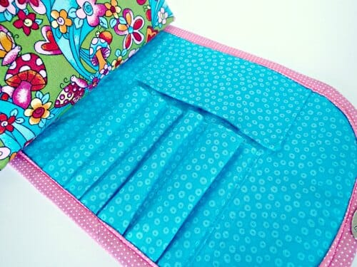 Free pattern and video tutorial to make this cute cosmetics bag with brush roll attached.