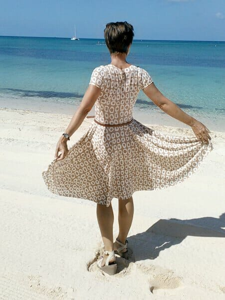 Free dress pattern.  Modest knit dress with sleeves and circle skirt.  Full video tutorial to show you how to make it too.  Perfect for work?
