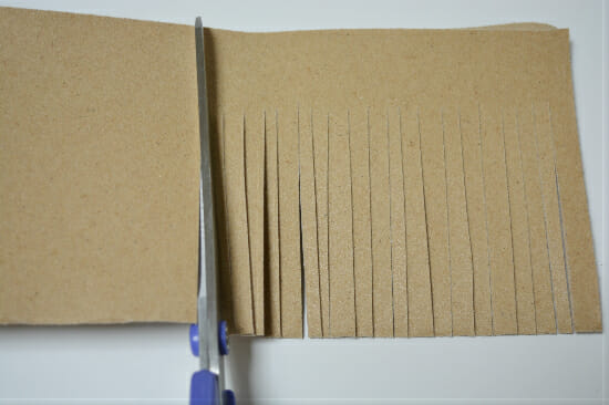 Sharpen scissors by cutting through sandpaper