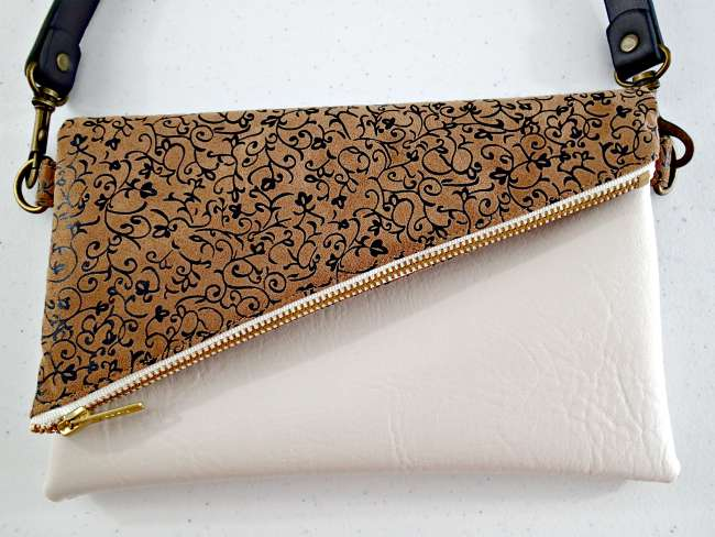 All in a Flap fold over clutch bag with options for shoulder or wrist strap. Easy to sew, uses very little fabric, instructions for using vinyl/suede etc too.