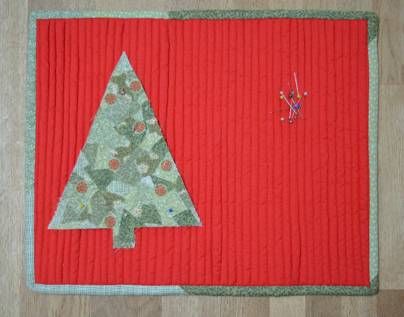 Pin scrappy fabric tree into place